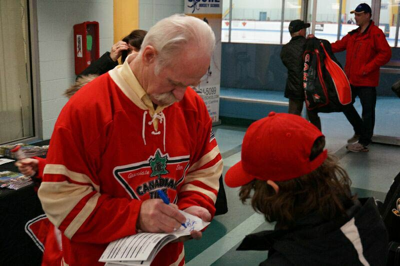 Former Leaf Lanny McDonald signing an autograph