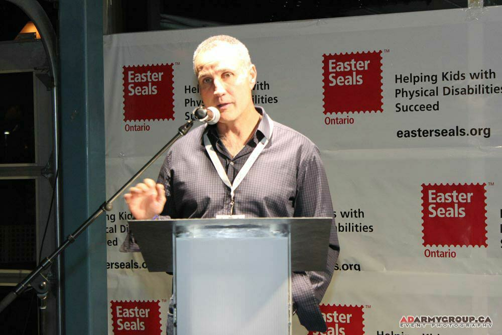 Former hockey pro Paul Coffey speaks at a charity event hosted by Jackson Events.